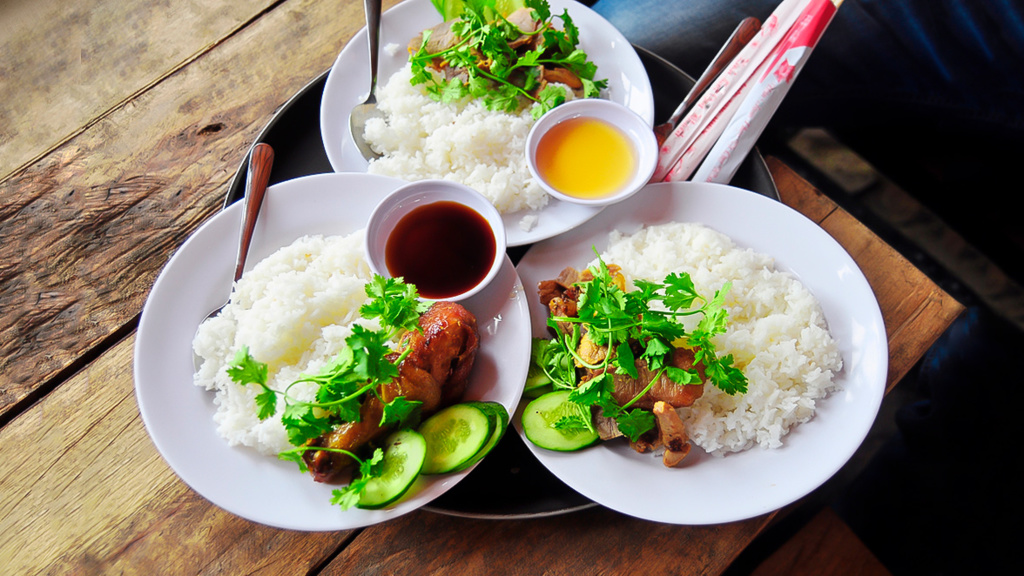 Com tam suon nuong - Partially broken rice topped with variety of meat dishes